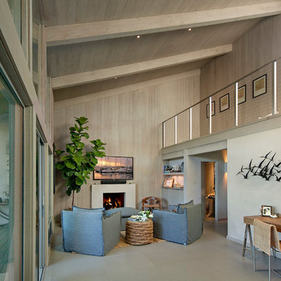 Inspiration for a mid-sized contemporary open concept porcelain tile family room remodel in Santa Barbara with gray walls, a standard fireplace and a wall-mounted tv