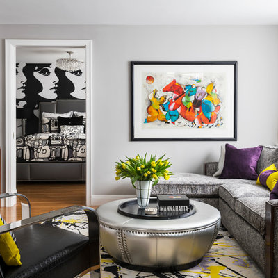 Family room - mid-sized contemporary family room idea in New York with gray walls, a wall-mounted tv and no fireplace