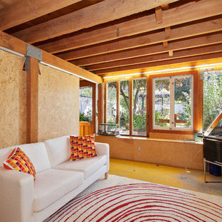 Inspiration for a contemporary enclosed concrete floor family room remodel in San Francisco with beige walls