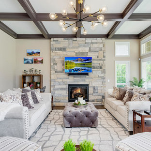 Elegant dark wood floor family room photo in Denver with beige walls, a wood stove, a stone fireplace and a wall-mounted tv
