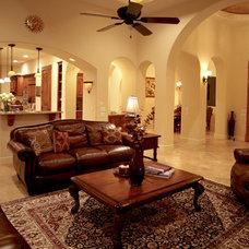Mediterranean Family Room by Alberto Jauregui Designs, Inc.