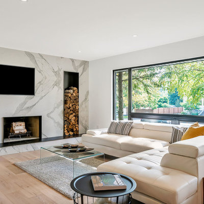 Large trendy open concept light wood floor and beige floor family room photo in Toronto with white walls, a standard fireplace, a tile fireplace and a wall-mounted tv