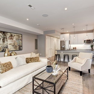 Mid-sized transitional open concept medium tone wood floor and brown floor family room photo in DC Metro with gray walls, a standard fireplace, a tile fireplace and no tv