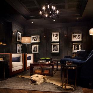 Foto di un soggiorno chic di medie dimensioni e chiuso con pavimento in legno massello medio, nessuna TV e pareti nere
