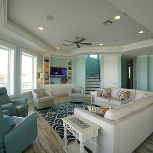 Family room - mid-sized beach style open concept porcelain floor family room idea in Houston with blue walls, no fireplace and a wall-mounted tv