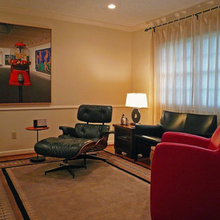 Inspiration for a large modern open concept medium tone wood floor family room remodel in Houston with beige walls and a media wall