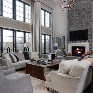 Inspiration for a large contemporary open concept dark wood floor family room remodel in Baltimore with gray walls, a standard fireplace, a stone fireplace and a wall-mounted tv