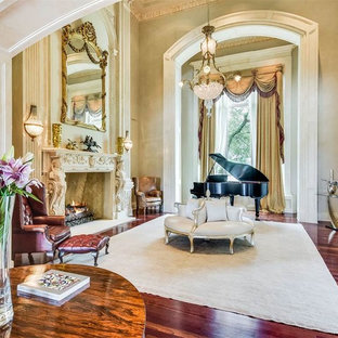 Inspiration for a mid-sized victorian open concept dark wood floor family room remodel in Austin with a music area, beige walls, a standard fireplace, a stone fireplace and no tv