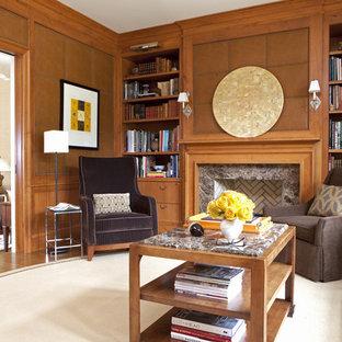 ワシントンD.C.のコンテンポラリースタイルのおしゃれなファミリールーム (ライブラリー、茶色い壁、標準型暖炉、石材の暖炉まわり) の写真