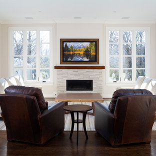 Mid-sized minimalist open concept dark wood floor and brown floor family room photo in DC Metro with beige walls, a standard fireplace, a stone fireplace and a concealed tv