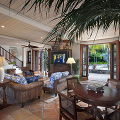 tropical family room by Barefoot Design Group, LLC