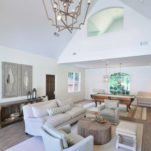 Inspiration for a coastal open concept game room remodel in Atlanta with white walls
