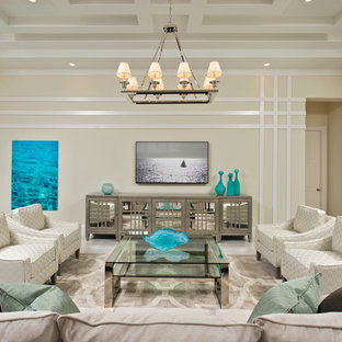 Inspiration for a tropical family room remodel in Miami with a bar and beige walls