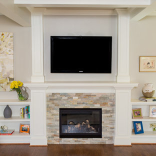 Family room - mid-sized transitional open concept dark wood floor family room idea in DC Metro with beige walls, a standard fireplace, a stone fireplace and a wall-mounted tv