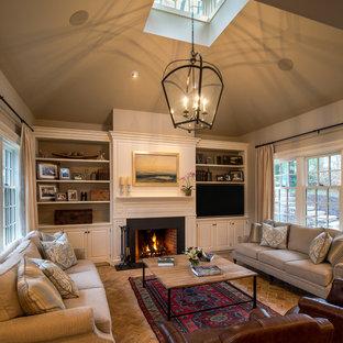 Idées déco pour une grande salle de séjour classique ouverte avec un mur beige, un sol en brique, une cheminée standard, un manteau de cheminée en bois, un téléviseur encastré et un sol marron.