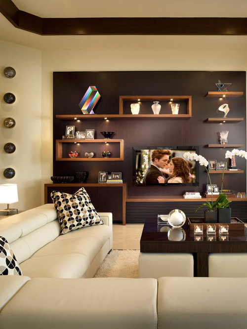 contemporary family room idea in detroit with beige walls and a wall mounted tv