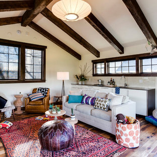 Family room - mid-sized eclectic open concept medium tone wood floor and brown floor family room idea in Portland with white walls and no fireplace