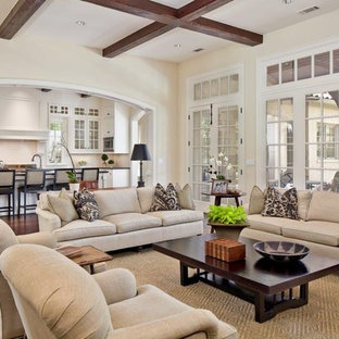 Family room - large transitional open concept dark wood floor and brown floor family room idea in Dallas with beige walls, a standard fireplace and no tv
