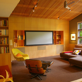 Midcentury family room in San Francisco with green walls, carpet and a built-in media wall.