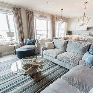 Immagine di un grande soggiorno costiero aperto con pareti grigie, pavimento in vinile e pavimento grigio