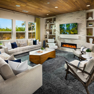 Inspiration for a contemporary family room remodel in San Diego with a ribbon fireplace, a brick fireplace and a wall-mounted tv