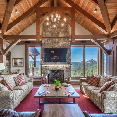 Mountain style family room photo in Denver with a standard fireplace, a stone fireplace and a wall-mounted tv