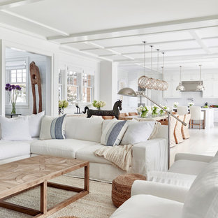 Example of a large trendy open concept light wood floor family room design in New York with white walls and a wall-mounted tv