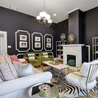 Inspiration for an eclectic enclosed light wood floor and beige floor family room remodel in Austin with black walls, a standard fireplace and a tile fireplace