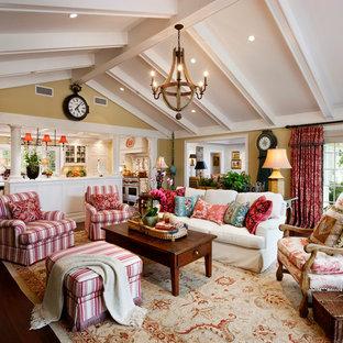 Family room - traditional open concept dark wood floor family room idea in Santa Barbara with beige walls
