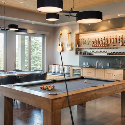 Trendy open concept dark wood floor and brown floor family room photo in Other with gray walls, no fireplace and no tv