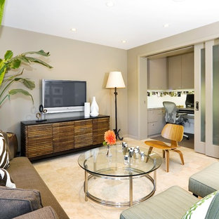 Example of a trendy enclosed family room design in San Francisco with beige walls and a wall-mounted tv