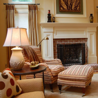 Example of a classic family room design in DC Metro with beige walls, a standard fireplace and a brick fireplace