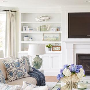 Idée de décoration pour une grande salle de séjour tradition ouverte avec un mur beige, un sol en bois brun, une cheminée standard, un manteau de cheminée en bois, un téléviseur fixé au mur et un sol marron.