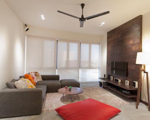 Trendy Concrete Floor And Black Family Room Photo In Singapore