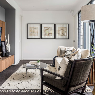 Mid-sized trendy enclosed carpeted and brown floor family room photo in Gold Coast - Tweed with white walls and a wall-mounted tv