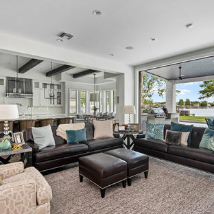 Inspiration for a large transitional open concept medium tone wood floor family room remodel in Orlando