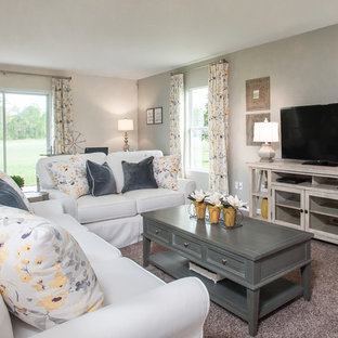 Large cottage chic open concept carpeted family room photo in Jacksonville with gray walls and a tv stand