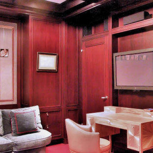 Inspiration for a huge modern enclosed carpeted family room remodel in New York with a wall-mounted tv and blue walls