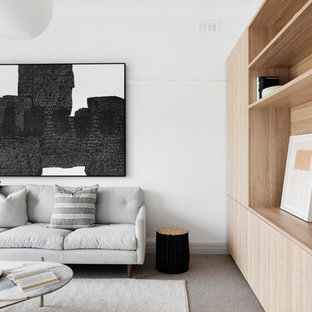 Arts and crafts family room in Melbourne with white walls, carpet and grey floor.