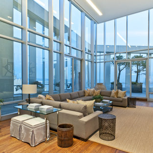 Inspiration for a contemporary open concept medium tone wood floor family room remodel in San Francisco