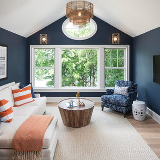 Example of a beach style light wood floor family room design in Minneapolis with blue walls, no fireplace and a wall-mounted tv