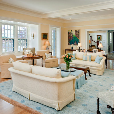 Large elegant open concept medium tone wood floor and beige floor family room photo in Boston with beige walls, no fireplace and no tv