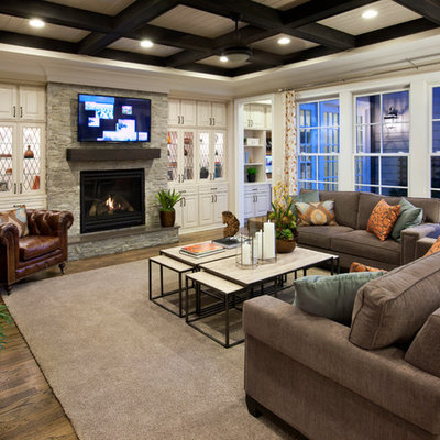 Family room - mid-sized traditional light wood floor family room idea in Raleigh with a standard fireplace, a wall-mounted tv, white walls and a stone fireplace