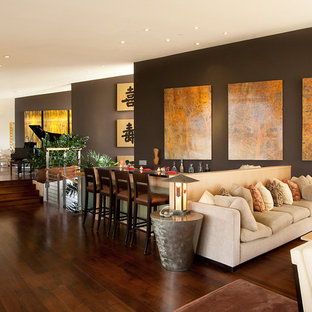Inspiration for an asian open concept dark wood floor family room remodel in San Francisco with brown walls