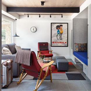 Foto di un piccolo soggiorno rustico chiuso con pareti bianche, nessun camino, nessuna TV e pavimento in ardesia