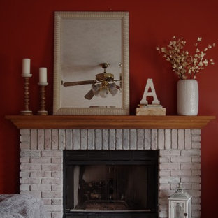 Family room - mid-sized rustic enclosed carpeted and beige floor family room idea in Cleveland with red walls, a standard fireplace, a brick fireplace and a corner tv