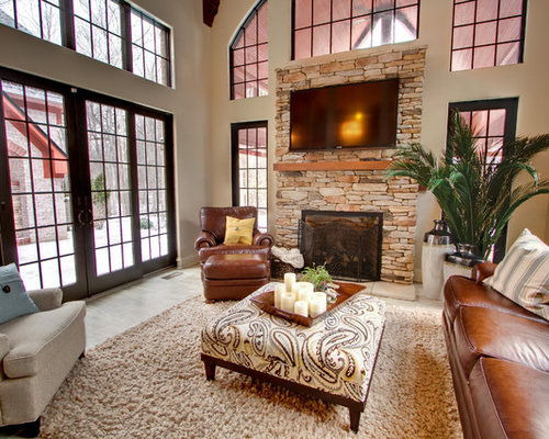 traditional family room idea in indianapolis with beige walls a standard fireplace a stone - Living Rooms With Ottomans