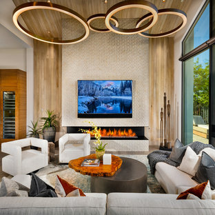 Inspiration for a contemporary family room remodel in Phoenix with a ribbon fireplace and a wall-mounted tv