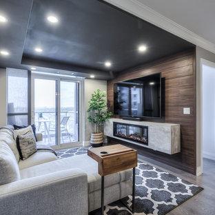 トロントの小さいコンテンポラリースタイルのおしゃれなファミリールーム (グレーの壁、無垢フローリング、吊り下げ式暖炉、木材の暖炉まわり、壁掛け型テレビ、グレーの床) の写真