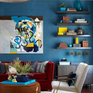 Immagine di un grande soggiorno design chiuso con pareti blu, parquet scuro, nessun camino e nessuna TV